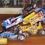 Craig Dollansky (7), Joey Saldana (71m), Cody Darrah (4) and Daryn Pittman go four-wide during Saturday's World of Outlaws STP Sprint Car Series feature at The Dirt Track at Charlotte Motor Speedway. (Justin Leedy Photo)