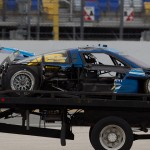 The Spirit of Daytona Racing Corvette DP is removed from the track after a wild crash during testing at Daytona Int'l Speedway. (Ted Rossino Photo)