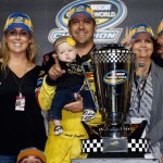 Series Champion Matt Crafton celebrates in Victory Lane with his wife Ashley and daughter Elladee after the NASCAR Camping World Truck Series Ford EcoBoost 200 at Homestead-Miami Speedway in Homestead, Florida. (Photo by Chris Graythen/Getty Images)