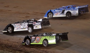 Darrell Lanigan (29), Josh Richards (1) and Scott Bloomquist battle for the race lead during Friday's World of Outlaws Late Model Series feature at The Dirt Track at Charlotte. (Dave Dalesandro Photo)