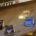 Darrell Lanigan (29) leads a pack of cars during Friday's World of Outlaws Late Model Series feature at The Dirt Track at Charlotte. (Dave Dalesandro Photo)