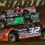 Bobby Pierce (32), Shane Clanton (25) and Tyler Reddick race three-wide during Saturday's World of Outlaws Late Model Series event at The Dirt Track at Charlotte Motor Speedway. (Chris Owens/ChrisOwens62.com Photo)