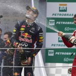 Fernando Alonso (right) sprays Mark Webber (center) and Sebastian Vettel with champagne after Sunday's Brazilian Grand Prix. (Steve Etherington Photo)