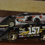 Mike Marlar (157) battles Clint Smith during World of Outlaws Late Model Series action on Saturday at The Dirt Track at Charlotte. (Chris Seelman Photo)