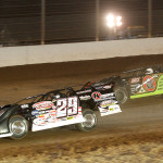 Darrell Lanigan (29) battles Scott Bloomquist for the race lead during Friday's World of Outlaws Late Model Series feature at The Dirt Track at Charlotte. (Dick Ayers Photo)