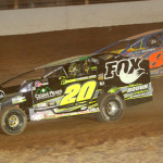 Brett Hearn (20) battles Matt Sheppard for the race lead during Friday's Super DIRTcar Series event at The Dirt Track at Charlotte. (Dick Ayers Photo)