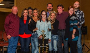 Harli White (center) is joined by her family and the family of the late Donnie Ray Crawford in receiving her 2013 Oil Capital Racing Series championship trophy. White became the first female champion in the 12 year old series. (Mike Spivey Photo)