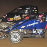 Bryan Clauson (20) battles eventual 2013 Budweiser Oval Nationals winner Dave Darland on at Perris (Calif.) Auto Speedway last year. (Ken Simon Photo)