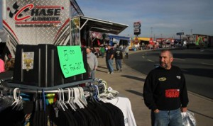 Fans shop for merchandise at last year's Race Ticket and Souvenir Blow-Out at Charlotte Motor Speedway. (CMS photo)