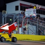 Brian Gerster crosses the finish line to win Saturday's Must See Racing Xtreme Sprint Series feature at Southern National Motorsports Park. (Chris Seelman Photo)