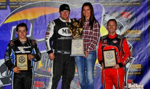 R.J. Johnson (center) won Thursday's sprint car feature during the 46th annual Western World Championship at Canyon Speedway Park. He is joined on the podium by runner-up Brady Bacon (left) and third-place Jerry Coons Jr. (Patrick Shaw photo)
