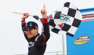 Kyle Larson, seen here celebrating his first NASCAR Camping World Truck Series victory in April at Rockingham (N.C.) Speedway, has won the NASCAR Nationwide Series Rookie of the Year Award. (Adam Fenwick Photo)