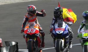 World champion Marc Marquez (93) and race winner Jorge Lorenzo make a victory lap Sunday in Valencia, Spain. (MotoGP photo)