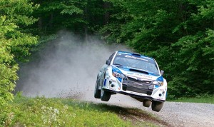 Five-Time Rally America Overall Champion and current Mt. Washington Hillclimb record-holder David Higgins from the Isle of Man and co-driver Craig Drew driving their 2013 Subaru WRX STI at the 2013 New England Forest Rally which is based in Newry, Maine.  (Photo: Alex Haugen)