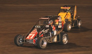 Kyle Larson leads Tracy Hines during the Turkey Night Grand Prix at Perris Auto Speedway last November. (Doug Allen photo)
