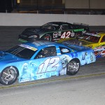 Augie Grill (112), Mike Garvey (1) and Steven Davis during the 2013 Snowflake 100 at Five Flags Speedway. (Chris Owens Photo)
