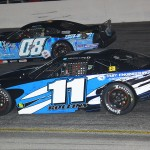 Johanna Long (11) works under Jake Griffin during Saturday's Snowflake 100 at Five Flags Speedway. (Chris Owens Photo)
