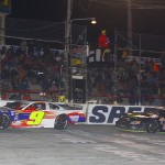 Chase Elliott (9) leads John Hunter Nemechek in the final laps of Saturday's Allen Turner Snowflake 100 at Five Flags Speedway. (Chris Owens Photo)