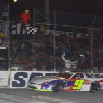 Chase Elliott crosses the finish line to win Saturday's Snowflake 100 at Five Flags Speedway. (Chris Owens Photo)