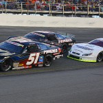 Erik Jones (51), Chase Elliott (9) and Grant Enfinger battle for the race lead during Sunday's Snowball Derby. (Chris Owens Photo)