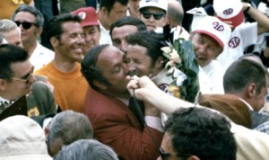 Andy Granatelli, seen here kissing Mario Andretti after his victory in the 1969 Indianapolis 500, has died at the age of 90. (IMS Archives Photo)