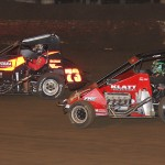 Dave Darland (73) and Damion Gardner battle for position during Thursday's Turkey Night Grand Prix at Perris (Calif.) Auto Speedway. (Doug Allen Photo)