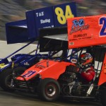 Bill Dunham (84) and  Larry Joe Scroufe race during the 600 class feature on Friday during the Rumble in Fort Wayne at the Memorial Coliseum Expo Center. (Chris Seelman Photo)