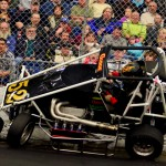 Isaac Chappell crashes just before the finish line during his midget heat race on Friday during the Rumble in Fort Wayne at the Memorial Coliseum Expo Center in Fort Wayne, Ind. (Chris Seelman Photo)