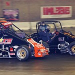Jim Anderson (99) and Mike Fedorcak battle during midget action on Saturday during the Rumble in Fort Wayne at the Memorial Coliseum Expo Center in Fort Wayne, Ind. (Gary Gasper Photo)