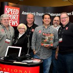 The crew at the National Speed Sport News booth at the 2013 PRI show in Indianapolis. (Joe Secka / JMS ProPhoto)