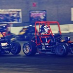 Justin Peck (5x) battles Russ Gamester for the race lead in the closing laps of Saturday's Rumble in Fort Wayne midget feature at the Memorial Coliseum Expo Center in Fort Wayne, Ind. (Gary Gasper Photo)