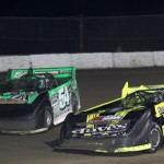 Mark Whitener (58) works his way through traffic en route to victory Saturday at North Florida Speedway. (R.E. Wing Photo)