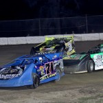 Bo Allen (71) and Mark Whitener (58) work their way through lapped traffic as they battle for the race lead during Saturday's event at North Florida Speedway. (R.E. Wing Photo)