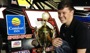 Erik Jones poses beside his race car with the Tom Dawson Trophy after being named the winner of the 2013 Snowball Derby at Five Flags Speedway on Sunday night. (KBM Photo)