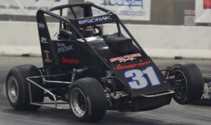 Derek Bischak shows his form during the 2012 Rumble in Fort Wayne at the Memorial Coliseum Expo. He and Billy Wease are the defending champions in the midget division. (Kevin Lillard Photo)