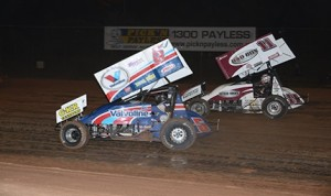 Eventual winner Steve Kinser (11) battles Max Dumesny during sprint car competition at Australia's Valvoline Raceway.