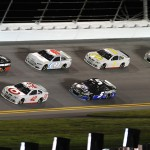 Dale Earnhardt Jr. (88) and Kyle Larson (42) lead a pack during a brief drafting test session on Friday night at Daytona Int'l Speedway. (HHP/Rusty Jarrett Photo)