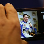 A member of the media snaps a picture of Jimmie Johnson during the NASCAR Sprint Media Tour. (HHP/Christa L. Thomas Photo)
