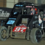 Christopher Bell (97) battles Ty Hulsey during heat race action on Chili Bowl J.C.T. Qualifying Night in January in Tulsa, Okla. (Dave Heithaus Photo)