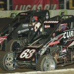 Bryan Clauson (63) holds off Christopher Bell in a battle for the race lead during the 2014 Lucas Oil Chili Bowl Midget Nationals in Tulsa, Okla. (Dave Heithaus Photo)