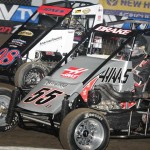 Nick Drake (55) battles P.J. Jones during heat race action on the first night of the 2014 Lucas Oil Chili Bowl Midget Nationals Tuesday in Tulsa, Okla. (Frank Smith Photo)