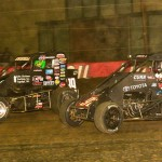Kevin Swindell (39) battles Christopher Bell for second place during the 2014 Lucas Oil Chili Bowl Midget Nationals feature on Saturday in Tulsa, Okla. (Ginny Heithaus Photo)