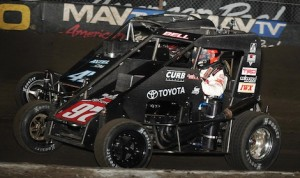 Christopher Bell (97) races under Damion Gardner Thursday night at the Lucas Oil Chili Bowl Nationals. (Frank Smith photo)
