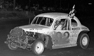 Dick Potts carries the checkered flag after a 1964 win at Rensselaer. (Stan Kalwasinski Collection)
