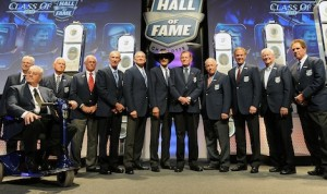 NASCAR Hall of Famers Leonard Wood, Maurice Petty, Junior Johnson, Dale Inman, Ned Jarrett, Dale Jarrett, Richard Petty, Bud Moore, Jack Ingram, Rusty Wallace, Bobby Allison, and Darrell Waltrip pose for a photo opportunity during the NASCAR Hall of Fame induction ceremony at NASCAR Hall of Fame on January 29, 2014 in Charlotte, N.C. (NASCAR photo)