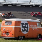 A pair of cars battle the high banks of Daytona Int'l Speedway behind an old school van on Sunday afternoon. (Ted Rossino Jr. Photo)