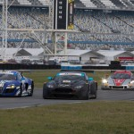 A pack of cars work the infield portion of the Daytona Int'l Speedway road course during Sunday's Roar Before the 24 test session. (Ted Rossino Jr. Photo)