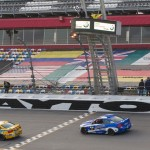 The No. 96 BMW M3 driven by Bill Auberlen and Paul Dalla Lana crosses the finish line to win the Continental Tire SportsCar Challenge BMW Performance 200 Friday at Daytona Int'l Speedway. Auberlen and Dalla Lana were later disqualified in post-race inspection. (Ted Rossino Jr. Photo)