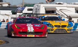 The No. 64 Ferrari works under the No. 94 BMW during GT competition as part of the 2014 Rolex 24. (Ted Rossino Jr. Photo)