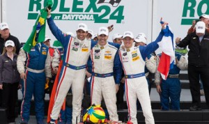 Joao Barbosa (left), Christian Fittipaldi (center) and Sebastien Bourdais celebrate after winning the 2014 Rolex 24 at Daytona Int'l Speedway. (Ted Rossino Jr. Photo)
